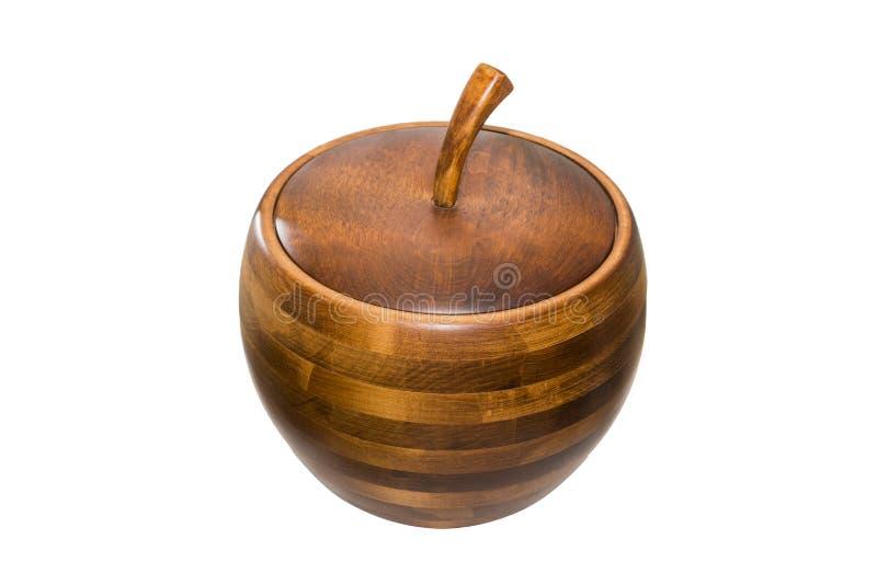 Tarro de galletas de madera rayado pomiforme con la tapa, aislada en whi fotografía de archivo