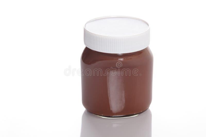 Tarro de la extensión de la avellana del chocolate imagen de archivo