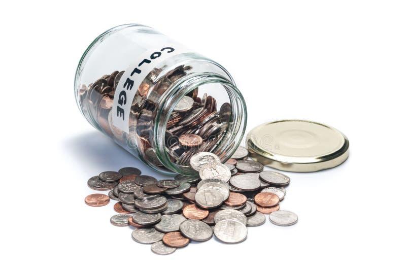 Tarro de la moneda de los ahorros de la universidad foto de archivo