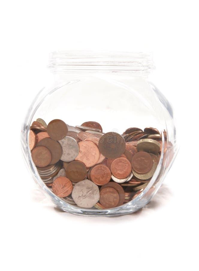 Tarro de monedas británicas del dinero en circulación fotos de archivo
