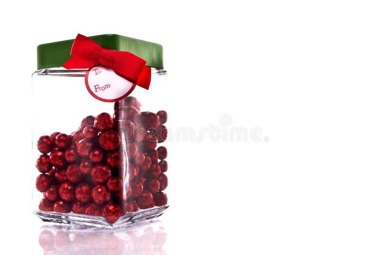 Tarro del caramelo con la etiqueta del caramelo y del regalo fotos de archivo