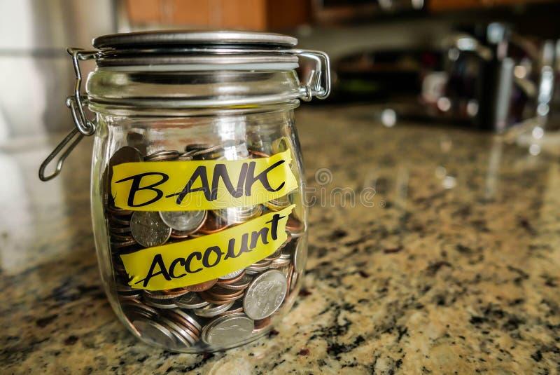 Tarro del dinero de la cuenta bancaria imagenes de archivo