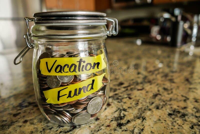Tarro del dinero del fondo de las vacaciones fotografía de archivo libre de regalías