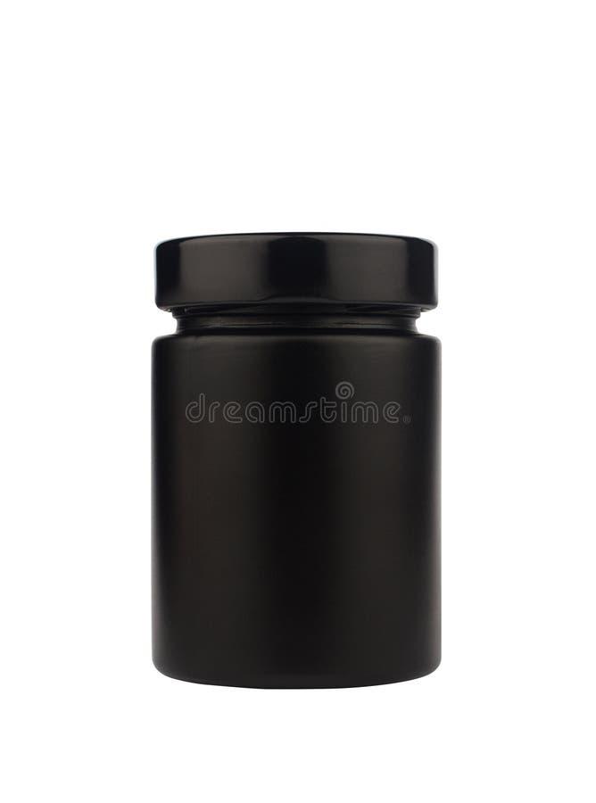 Tarro negro oscuro con el casquillo aislado en blanco imagen de archivo libre de regalías