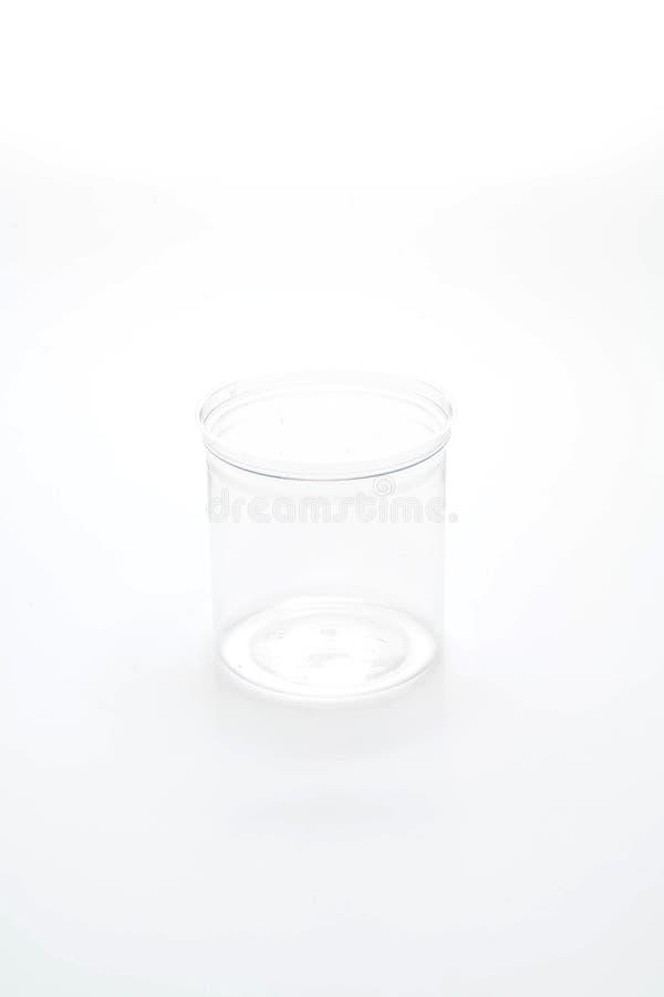 tarro plástico vacío imagenes de archivo
