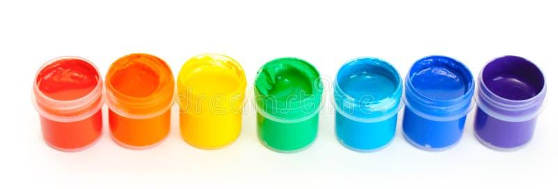 Tarros con gouache multicolora fotografía de archivo