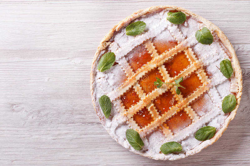 Tart with apricot jam horizontal view from above stock photo