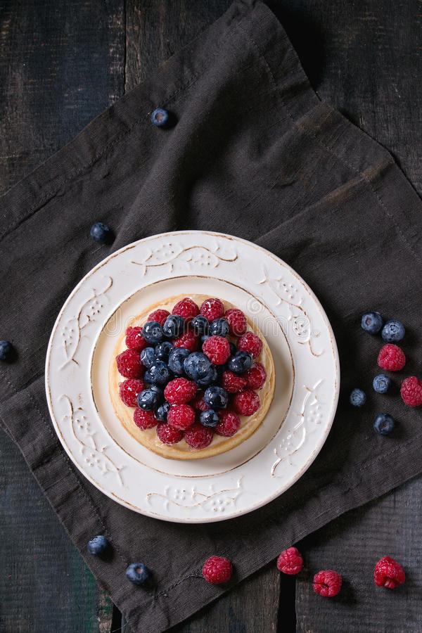 Tart with fresh berries royalty free stock photography