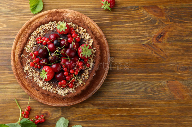 Tart with fruits top view. Food background stock images