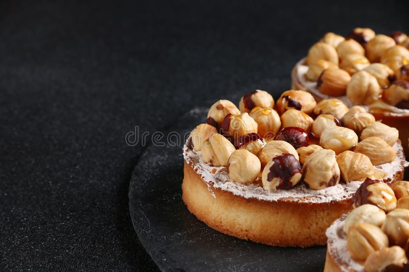 Tart with nuts and honey on dark background stock photos