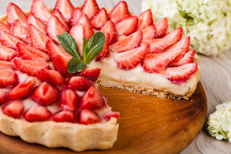 Tart with strawberries royalty free stock image