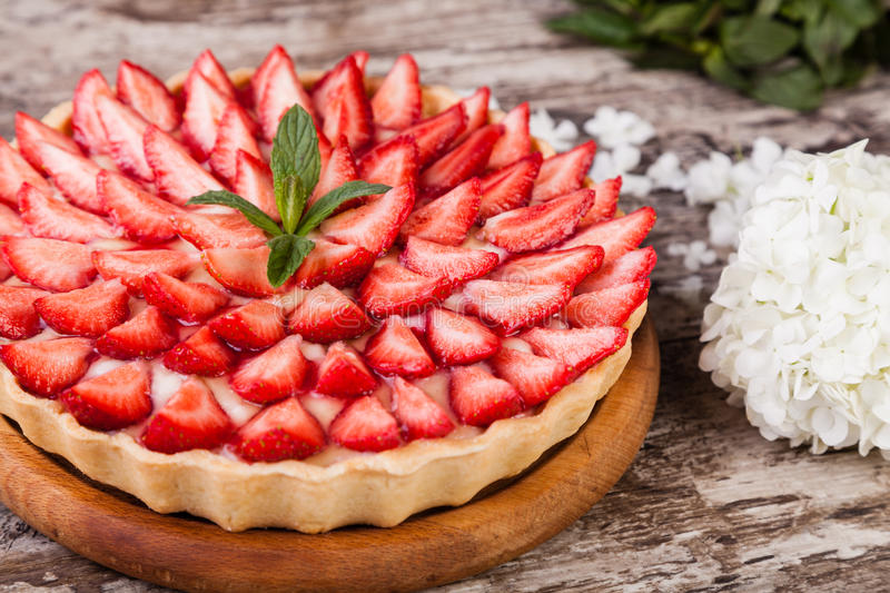 Tart with strawberries royalty free stock photo