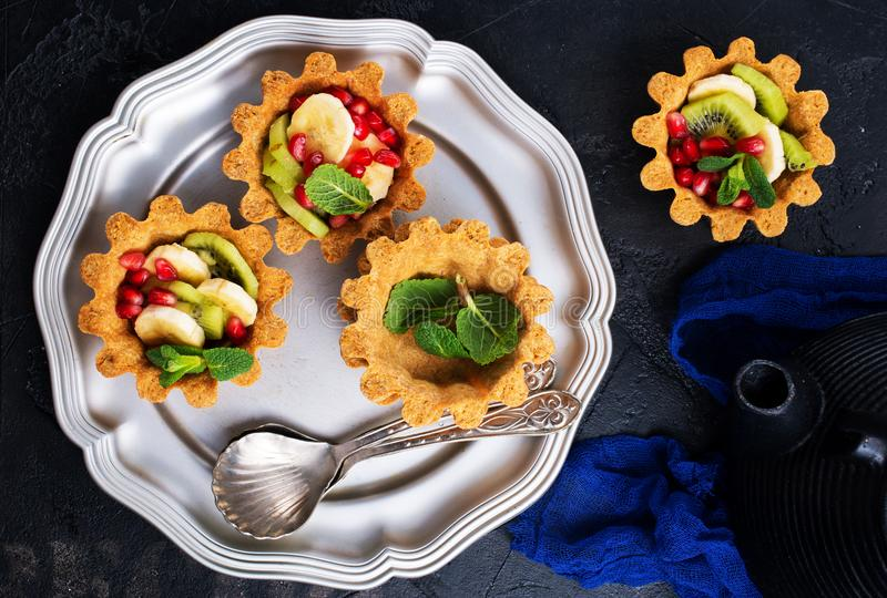 Tartalets with berries royalty free stock photo