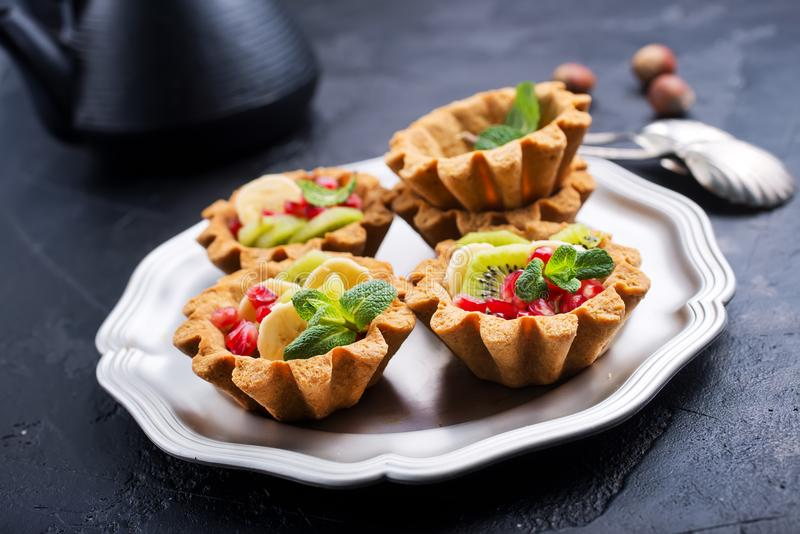 Tartalets with berries stock photography