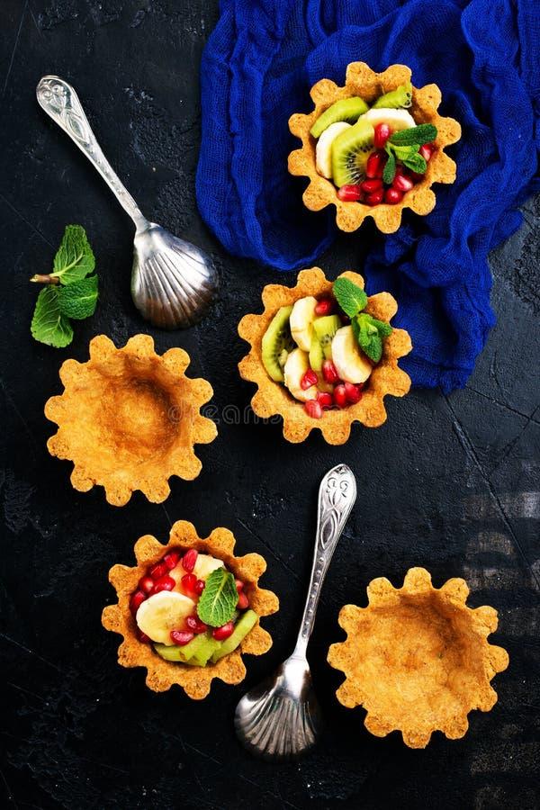Tartalets met bessen stock foto
