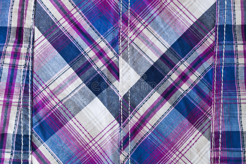 Tartan fabric. With seam, as a background image royalty free stock image