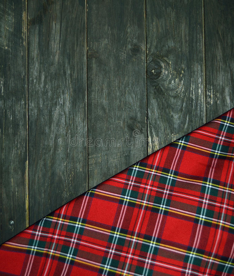 Tartan. Textile on wooden background stock image