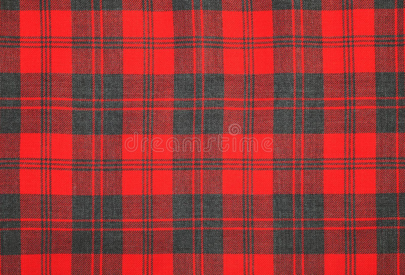 Tartan wool. Red and grey tartan fabric royalty free stock images