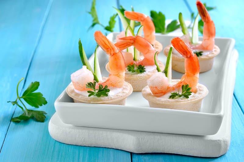 Tartelettes avec des crevettes photographie stock