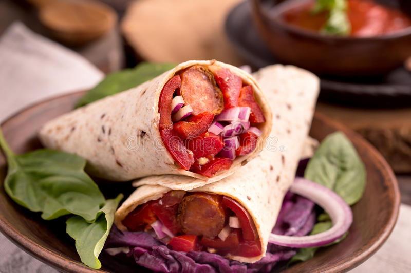 Tartillas wraps with sausage and vegetables royalty free stock photo