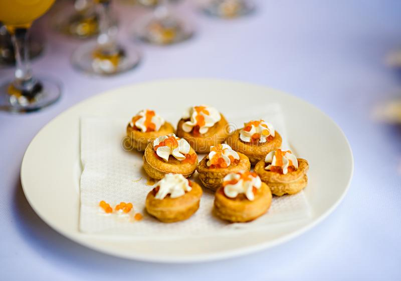 Tartlets with cheese and red caviar. Selective focus royalty free stock photography