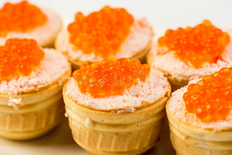 Tartlets with cheese and red caviar. Selective focus. Copy space stock photos