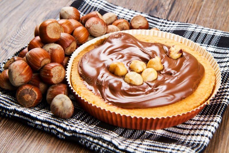 Tartlette con crema del chocolate y de la avellana imagen de archivo