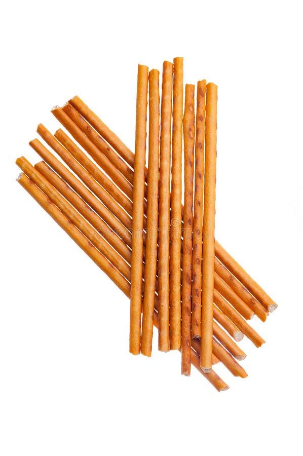 Tas des batons de pain salés d'isolement sur le fond blanc images stock