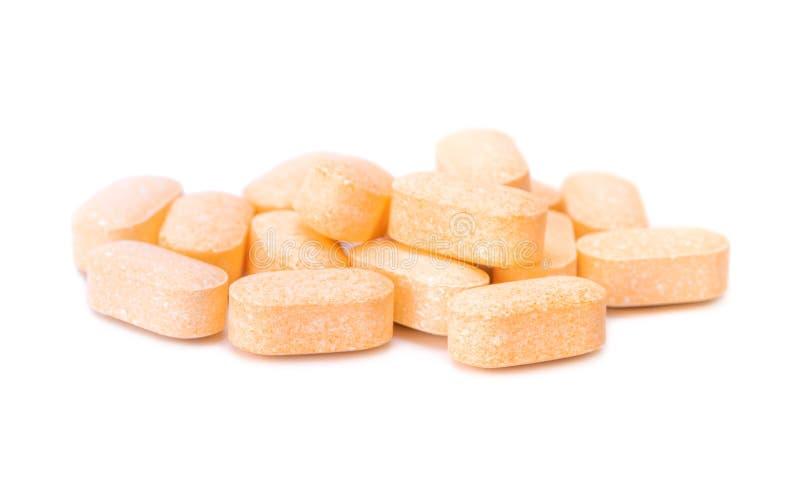 Tas des comprimés de vitamine C image stock