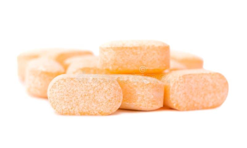 Tas des comprimés de vitamine C photographie stock
