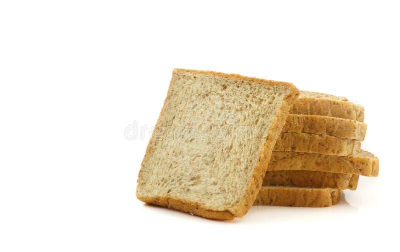 Tas des pains coupés en tranches de blé entier photographie stock