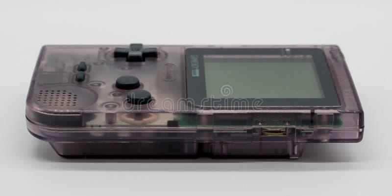 Tasca porpora di Game Boy, gioco portatile d'annata da Nintendo illus fotografia stock