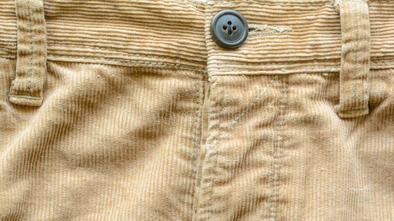 Tasche in der beige Samt-Hosen-Nahaufnahme stockbilder