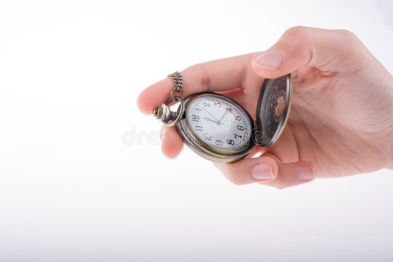 Taschen-Uhr in der Hand stockbilder