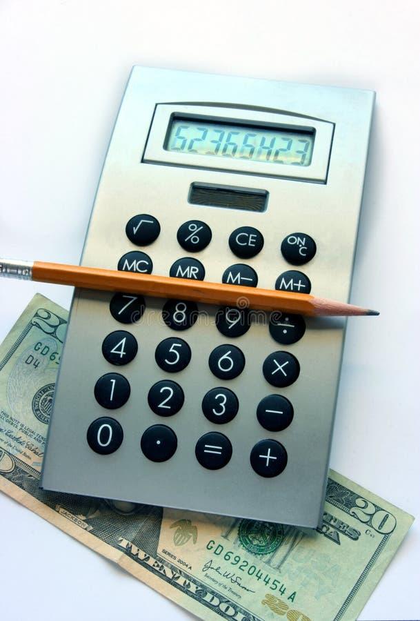 Taschenrechner, Bleistift und zwanzig Dollarschein stockfotografie
