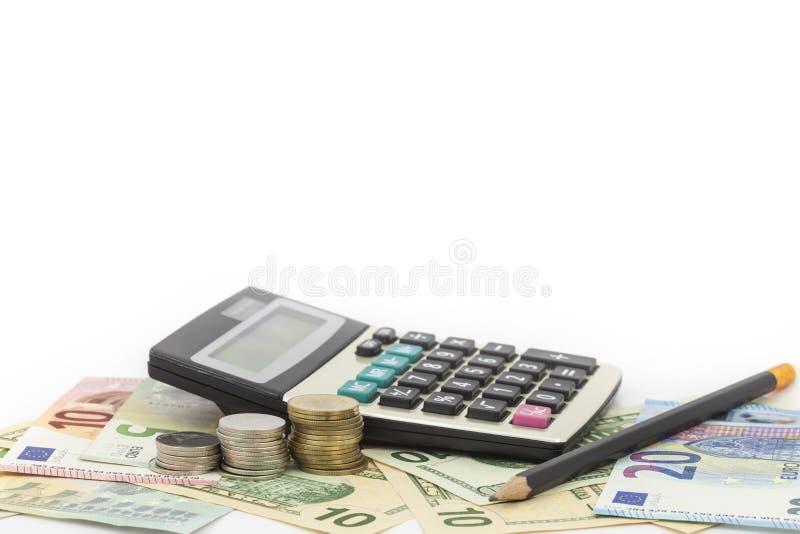 Taschenrechner mit Münze, Bleistift auf Geldbanknoten Euro und Dollar stockfoto