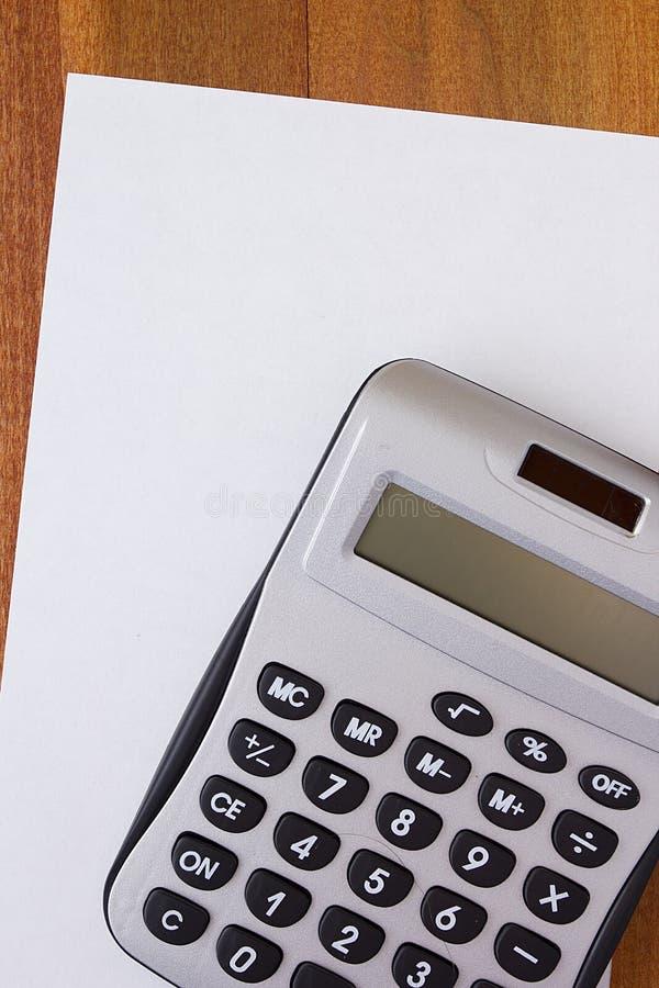 Taschenrechner-und Papier Buchstabe lizenzfreies stockbild