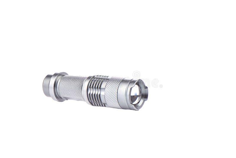 Taschentaschenlampe in einem Metallkasten auf einem weißen Hintergrund lizenzfreies stockbild