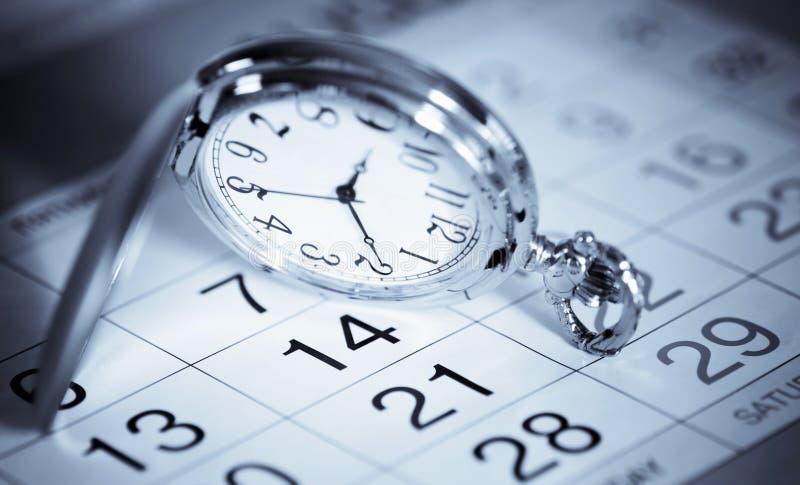 Taschenuhr und -kalender lizenzfreie stockfotos