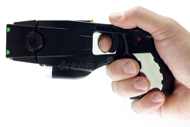 Taser gun. A modern day taser isolated on a white background stock photography