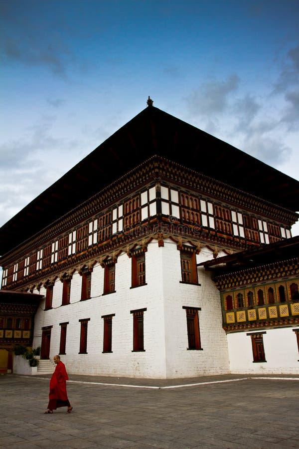 The Tashi Chho Dzong Fortress with blue skies and monk, Thimpu, Bhutan royalty free stock photo