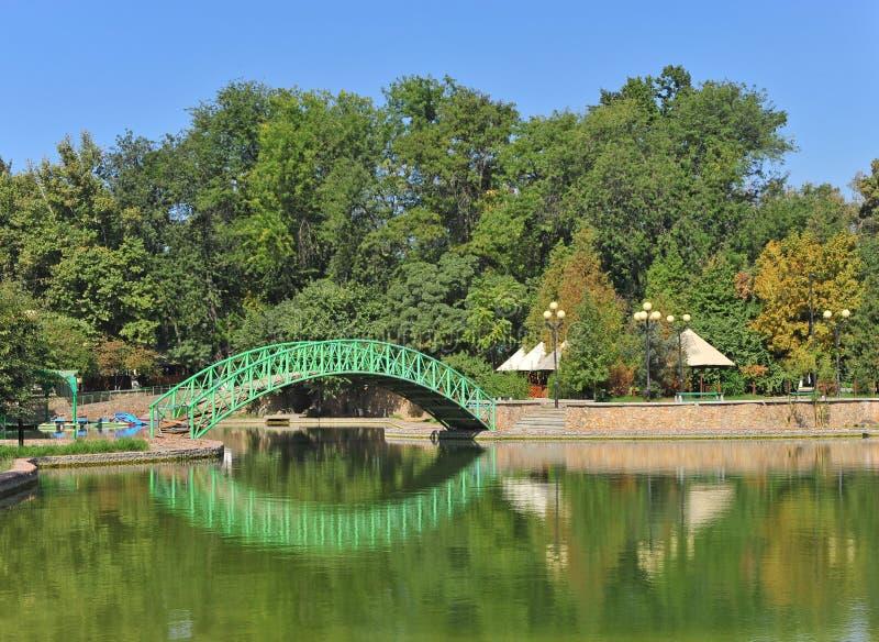 Tashkent: green metal bridge on canal royalty free stock image