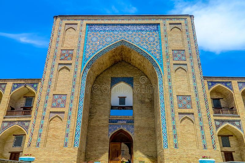 Tashkent Kukeldash Madrasa 01. Tashkent Kukeldash Madrasa Main Gate Entrance Iwan Picturesque Breathtaking Frontal Viewpoint royalty free stock image