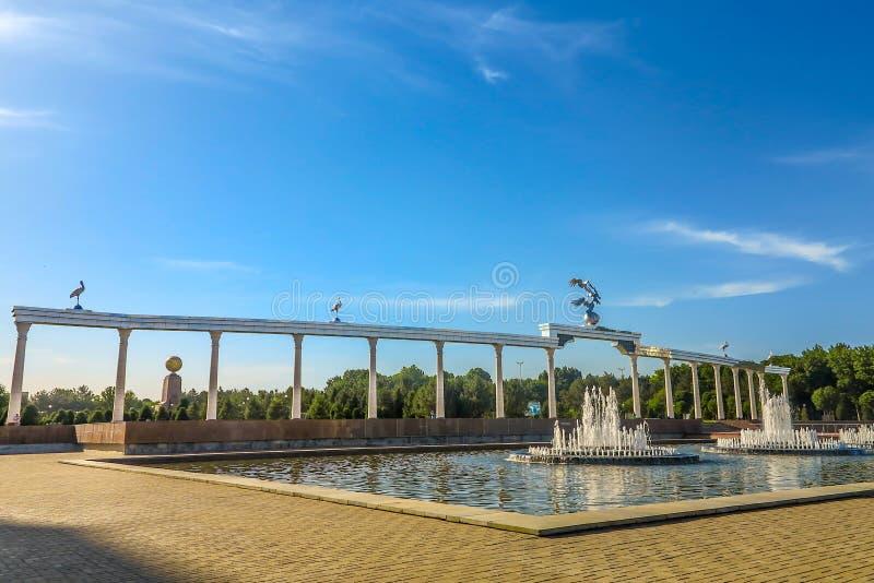 Tashkent Mustaqilliq Maidoni 08. Tashkent Picturesque Breathtaking Mustaqilliq Maidoni Main Fountain Square with Gate royalty free stock image