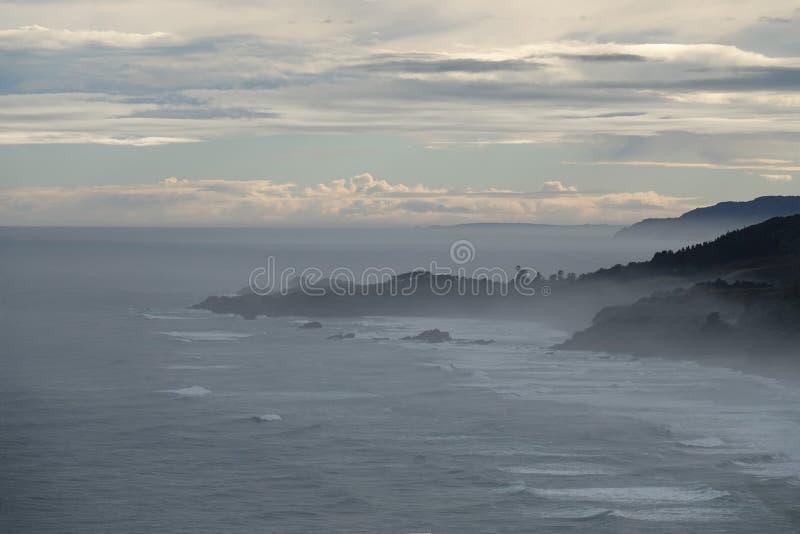 Tasman Sea in mist on West Coast of New Zealand. Tasman Sea near Punakaiki on the way to Cape Foulwind on the West Coast of the South Island of New Zealand stock photo