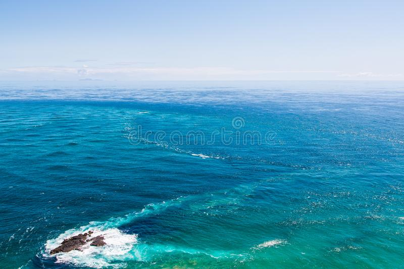 Tasman Sea and South Pacific Ocean. This is where two bodies of water, Tasman Sea and South Pacific Ocean meet. The currents can be clearly seen stock photos