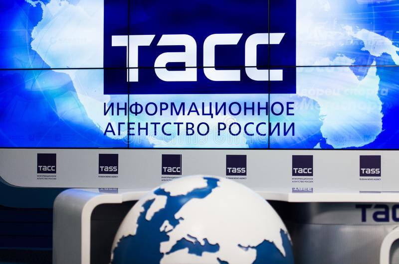 TASS sign with a globe on foreground during Press conference of International Karate Tournament `KARATE 1 - PREMIER LEAGUE`. MOSCOW, RUSSIA - OCTOBER 3, 2019 stock photo