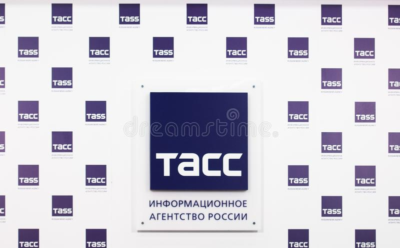 TASS sign on the wall during Press conference of International Karate Tournament `KARATE 1 - PREMIER LEAGUE`. MOSCOW, RUSSIA - OCTOBER 3, 2019: TASS sign on the stock photos