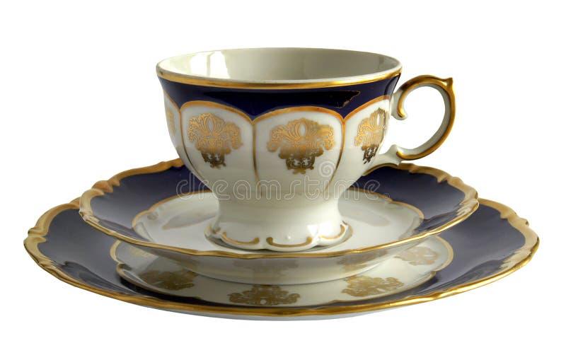 Tasse antique de porcelaine avec la soucoupe et le plat photo libre de droits