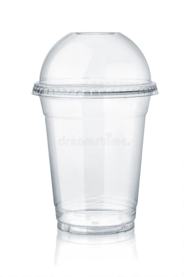 Tasse claire en plastique avec le couvercle de dôme image libre de droits
